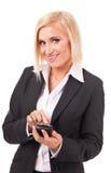 Mulher de negócios que usa o telefone esperto da tela de toque fotografia de stock