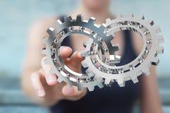 Mulher de negócios que usa a rendição moderna de flutuação do mecanismo de engrenagem 3D Foto de Stock Royalty Free