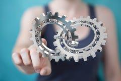 Mulher de negócios que usa a rendição moderna de flutuação do mecanismo de engrenagem 3D Imagem de Stock Royalty Free