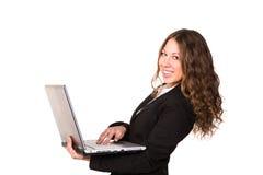 Mulher de negócios segura bonita com portátil Fotografia de Stock Royalty Free