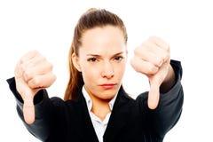 Mulher de negócios severa com polegar para baixo sobre Imagem de Stock Royalty Free