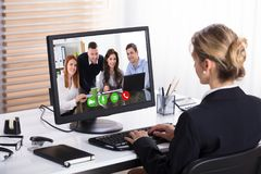 Mulher de negócios Video Conference With seus colegas foto de stock royalty free