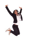 Mulher de negócio americana africana nova que salta, conceito do sucesso Imagens de Stock Royalty Free