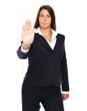 Mulher de negócio que mostra o sinal da parada da mão Imagem de Stock
