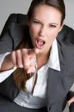 Mulher de negócios apontando louca Fotografia de Stock