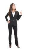 Mulher de negócios que aponta no fundo branco Fotografia de Stock