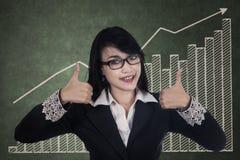 Mulher de negócios que dá os polegares acima Fotografia de Stock Royalty Free