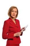 Mulher de negócios que prende um e-livro Foto de Stock