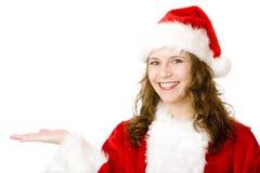 A mulher de Papai Noel prende a mão para a placa do sinal do anúncio Fotos de Stock