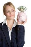 Mulher de pensamento do banco Piggy Imagens de Stock