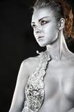 Mulher de prata congelada que olha o lado foto de stock royalty free