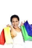 Mulher de riso com sacos de compras coloridos Fotos de Stock
