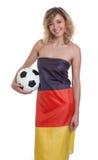 Mulher de riso na bandeira alemão com bola Imagens de Stock Royalty Free