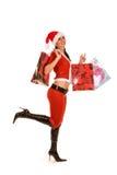 Mulher de Santa com sacos de compra imagem de stock