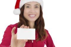 Mulher de Santa com um cartão do sinal Imagens de Stock