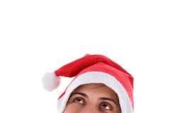 Mulher de Santa do Natal que olha acima Fotos de Stock Royalty Free