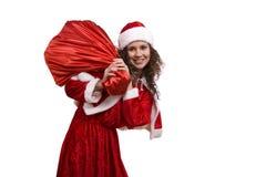 A mulher de Santa está prendendo o saco vermelho com presentes. imagem de stock royalty free