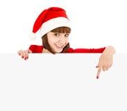 Mulher de Santa que aponta no quadro de avisos em branco do sinal Imagens de Stock Royalty Free
