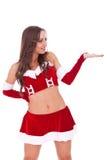 Mulher de Santa que apresenta algo Imagem de Stock Royalty Free