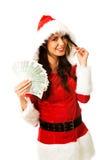 Mulher de Santa que guarda um grampo do dinheiro polonês Foto de Stock
