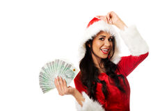 Mulher de Santa que guarda um grampo do dinheiro polonês Imagem de Stock