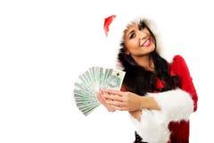 Mulher de Santa que guarda um grampo do dinheiro polonês Imagem de Stock Royalty Free