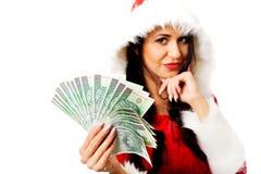Mulher de Santa que guarda um grampo do dinheiro polonês Fotos de Stock Royalty Free