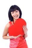 Mulher de sorriso atrativa com coração imagens de stock