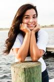 Mulher de sorriso com mãos na face Imagens de Stock Royalty Free