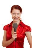 Mulher de sorriso com microfone Imagens de Stock