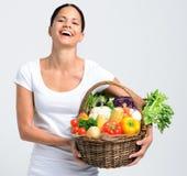 Mulher de sorriso com produtos frescos Imagens de Stock