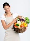 Mulher de sorriso com produtos frescos Fotos de Stock Royalty Free