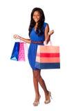 Mulher de sorriso da compra do consumidor foto de stock