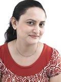 Mulher de sorriso da origem indiana Fotografia de Stock