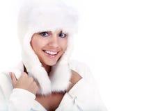 Mulher de sorriso do inverno. olhos azuis Foto de Stock Royalty Free