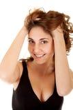 Mulher de sorriso em um vestido preto Foto de Stock Royalty Free