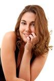 Mulher de sorriso em um vestido preto Fotografia de Stock Royalty Free
