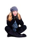 Mulher de sorriso na roupa do inverno sobre o branco Foto de Stock Royalty Free