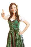 Mulher de sorriso no vestido do dirndl Imagens de Stock Royalty Free