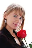 A mulher de sorriso nova bonita com levantou-se Imagem de Stock