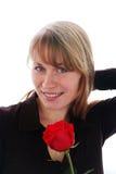 A mulher de sorriso nova bonita com vermelho levantou-se Fotos de Stock