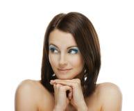 A mulher de sorriso olha askance Fotografia de Stock Royalty Free