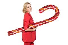 Mulher de sorriso que guarda Lollypop grande Ano novo feliz Foto de Stock