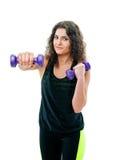 Mulher desportiva com pesos de aço pesados imagem de stock royalty free