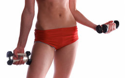 Mulher desportiva nova com dumbbell Fotos de Stock