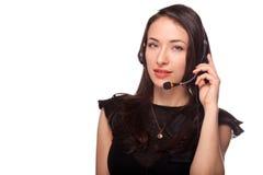 Mulher do apoio do centro de atendimento com auriculares Fotografia de Stock