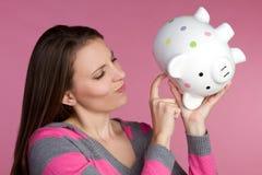 Mulher do banco Piggy Foto de Stock Royalty Free