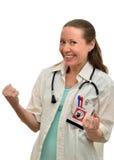 A mulher do doutor exulta o tratamento bem sucedido de seu paciente fotografia de stock royalty free