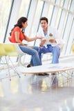 Mulher do doutor Offering Counselling Deprimido Fotografia de Stock