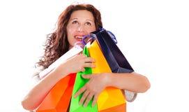 Mulher do entusiasta da compra que abraça sacos imagens de stock